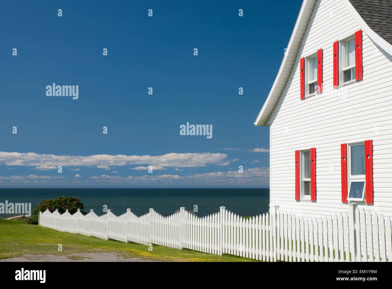 White house with red trim and a white picket fence by the - White house white trim ...