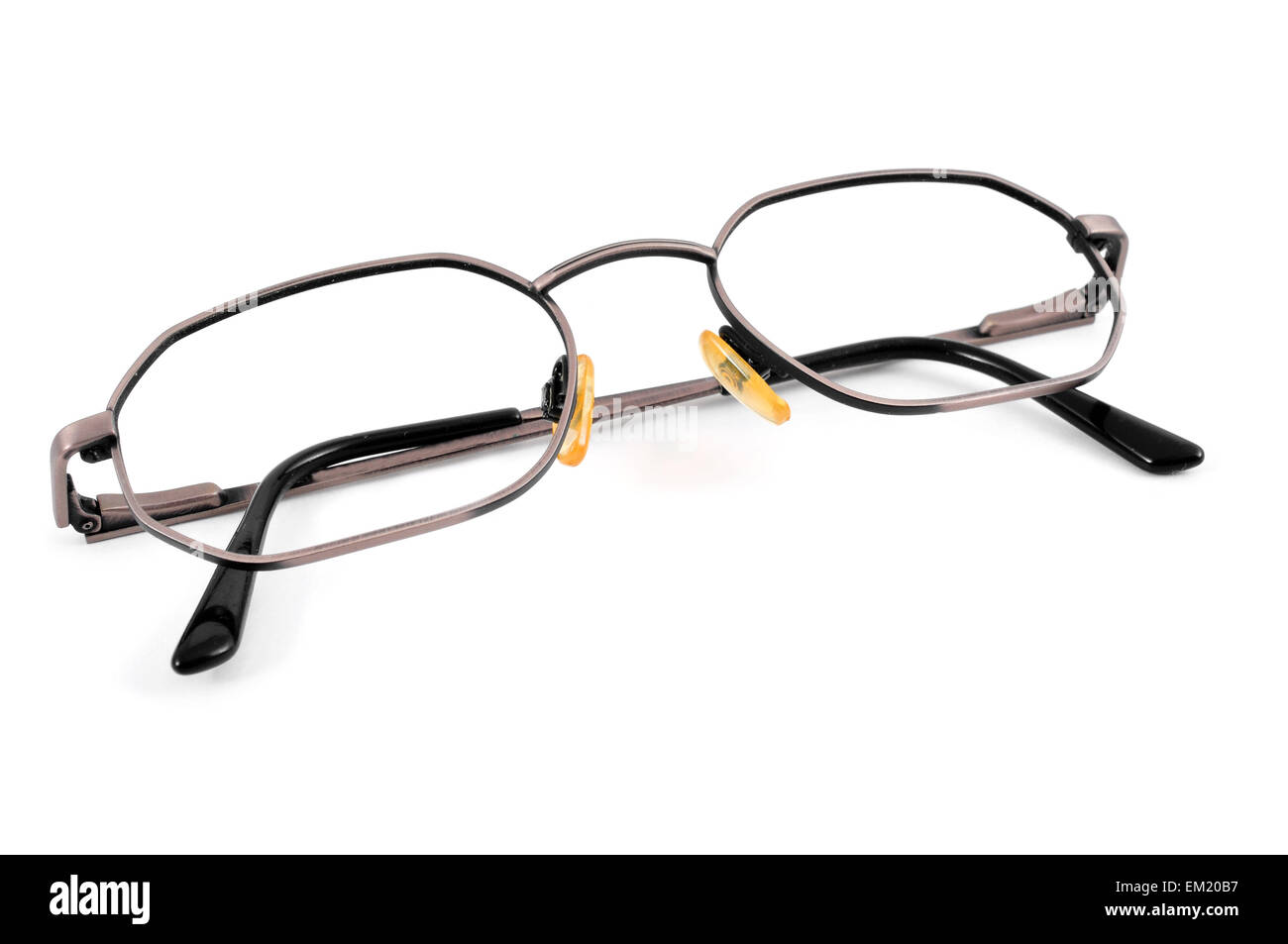 closeup of a pair of metal-rimmed eyeglasses on a white background - Stock Image