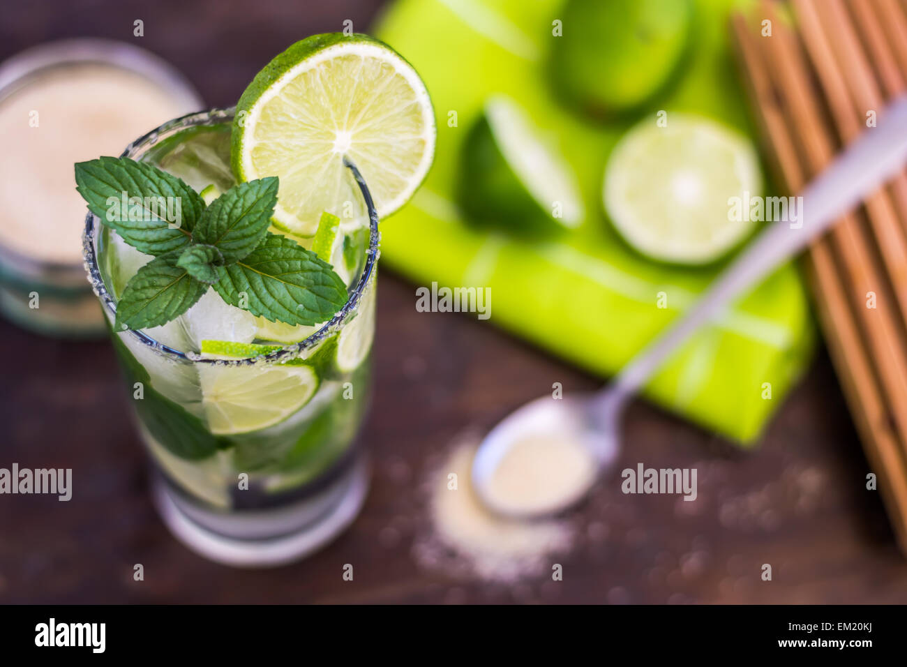 Mojito Lime Alcoholic Drink Cocktail on Wooden Table - Stock Image