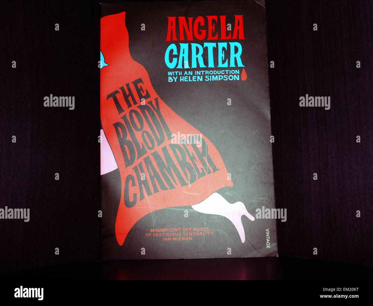 The Bloody Chamber by Angel Carter photographed against a black background. - Stock Image