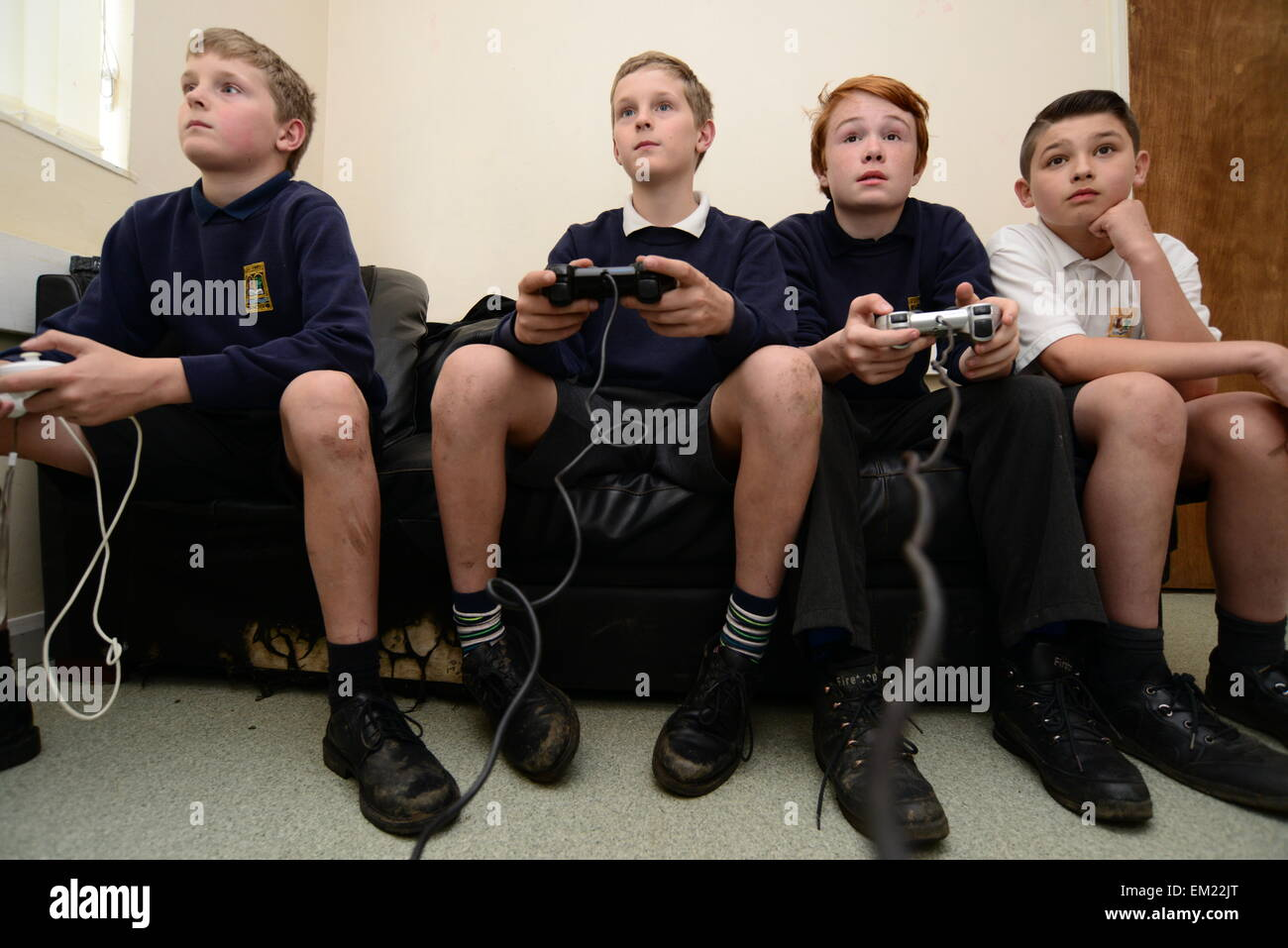 Young boys playing on a Sony Playstation. Picture: Scott Bairstow/Alamy - Stock Image