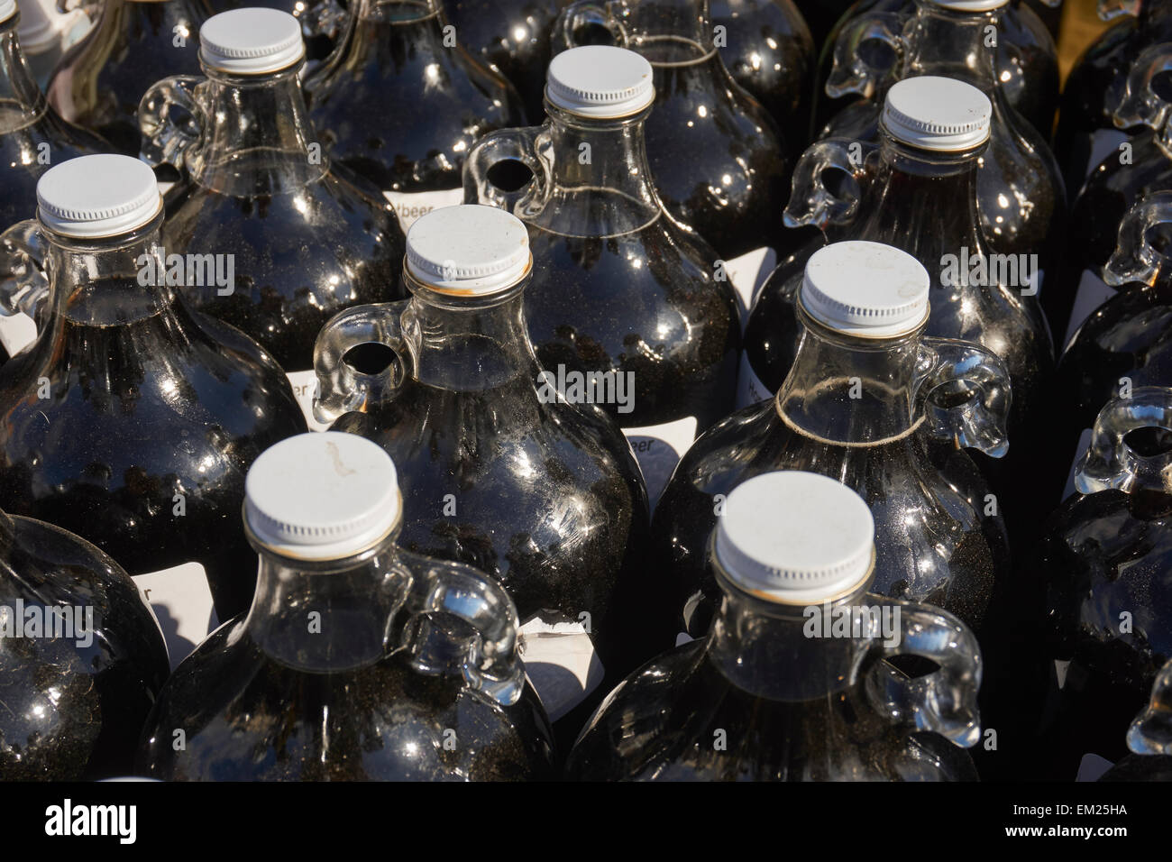 Bottles of Amish-made artisan root beer at an outdoor market (sometimes called a 'mud sale'), Wakefield, - Stock Image