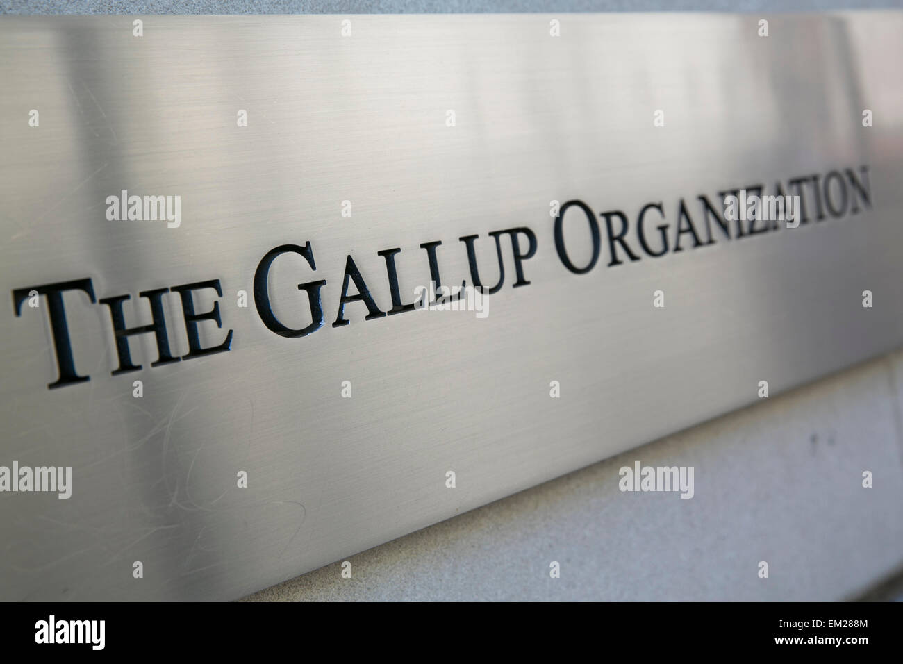 A sign on the exterior of the headquarters of the polling firm, The Gallup Organization in downtown Washington, - Stock Image