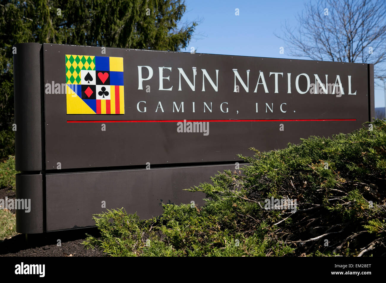 A logo sign outside the headquarters of Penn National Gaming, Inc., in Wyomissing, Pennsylvania. - Stock Image