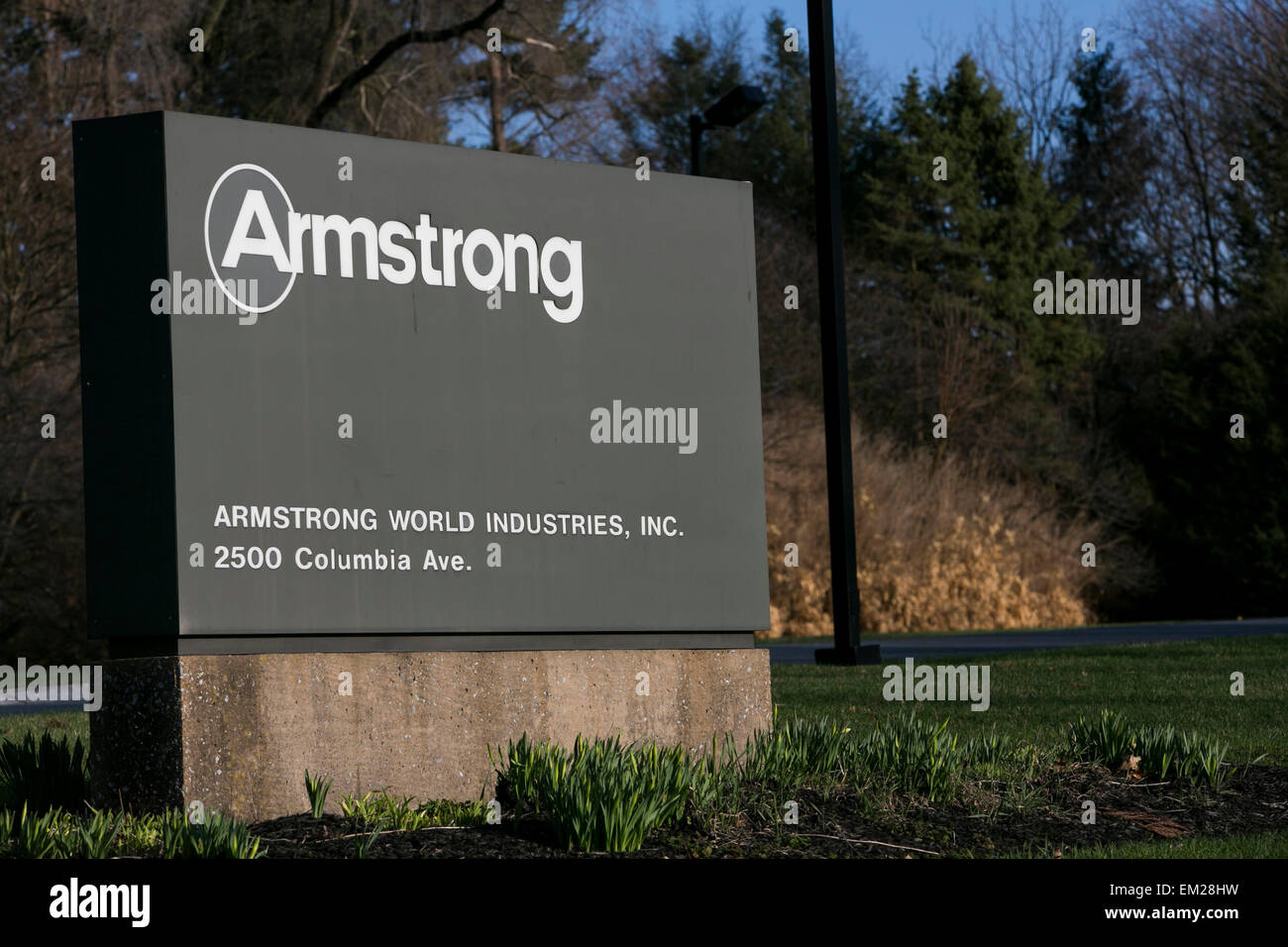 A logo sign outside the headquarters of Armstrong World Industries, Inc., in Lancaster, Pennsylvania. - Stock Image