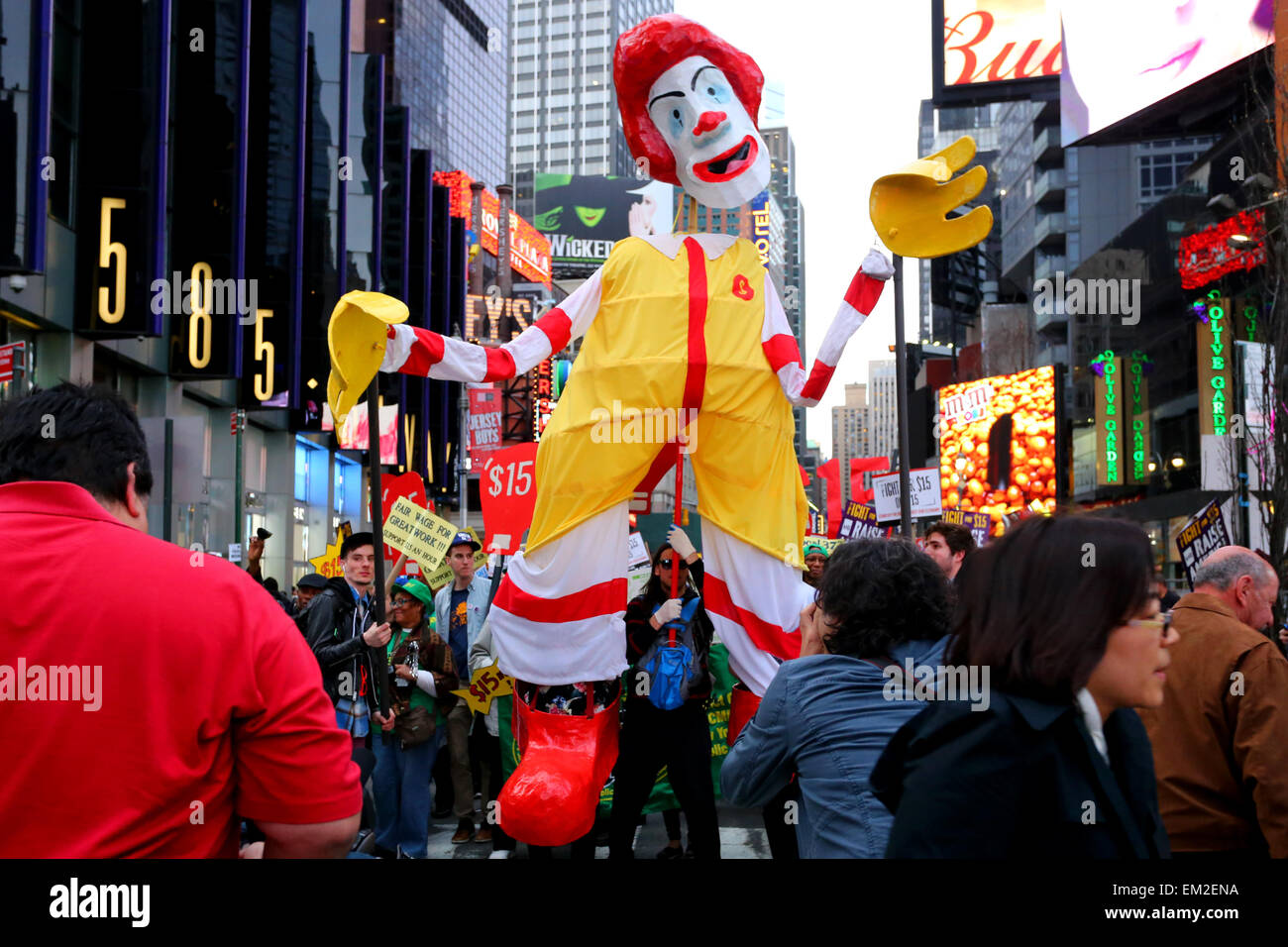 Activists parade a large 'Ronnie McDonalds' puppet at a Fight for $15 demonstration in Times Square - Stock Image