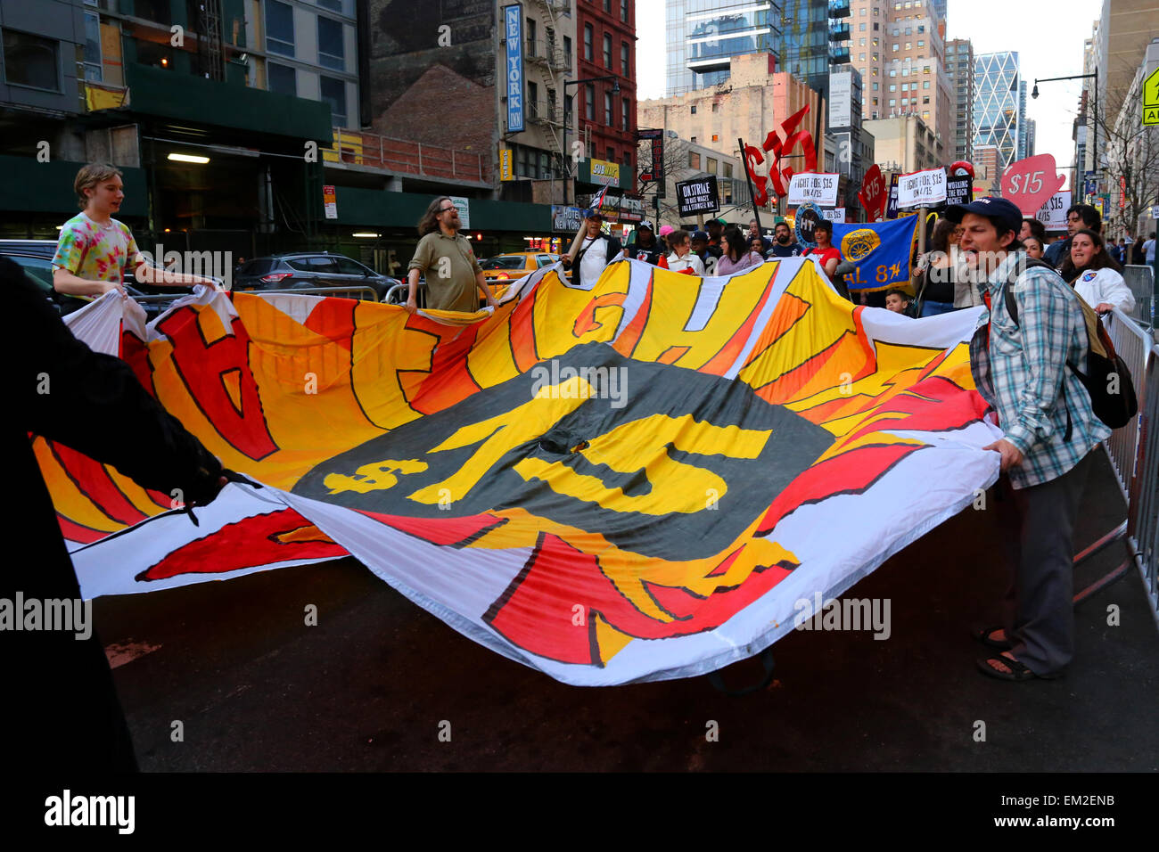 Activists unfurl a large parachute banner demonstrating in favor of a $15 an hour living wage. - Stock Image