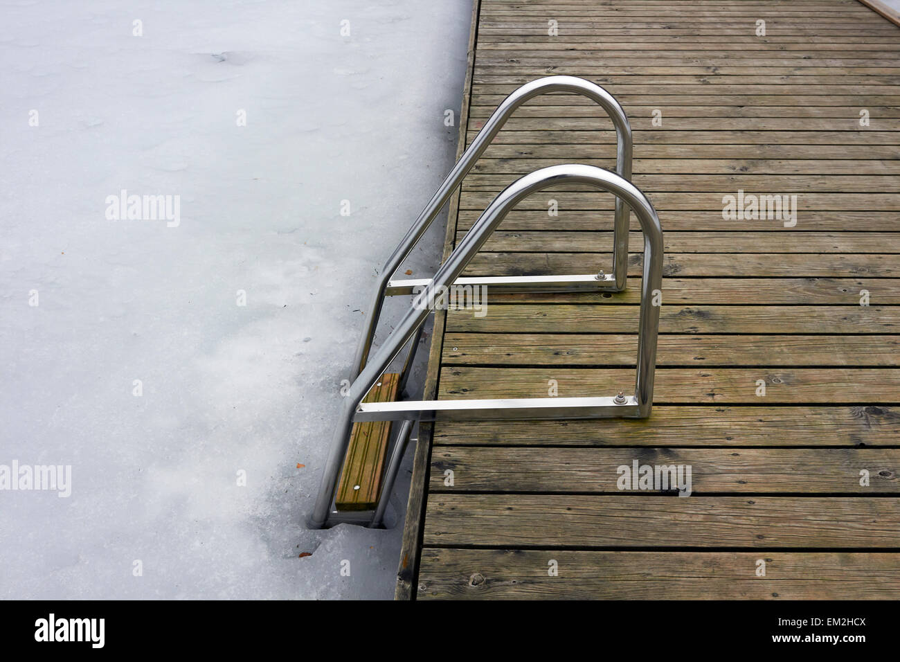 hand-rails leading to frozen lake, Finland - Stock Image