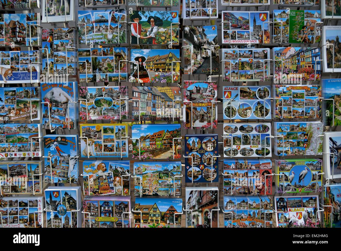 Postcard stand with Alsace postcards, Obernai, Bas-Rhin, Alsace, France - Stock Image