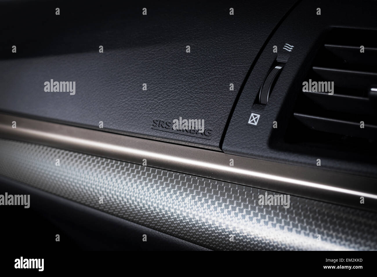 Modern car dashboard airbag closeup - Stock Image