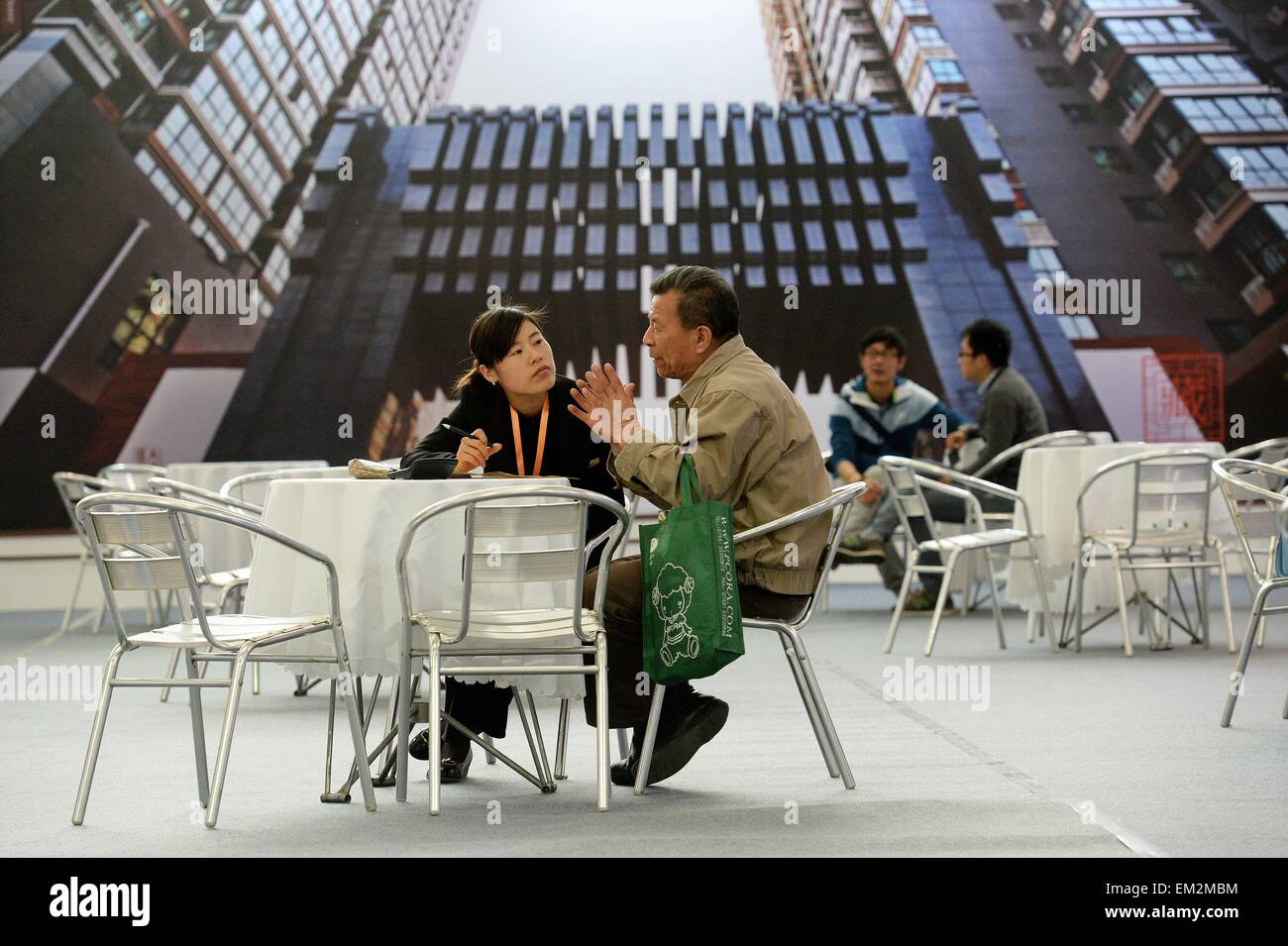 (150416) -- XI'AN, April 16, 2015 (Xinhua) -- A resident consults about house property information at the Xi'an Stock Photo