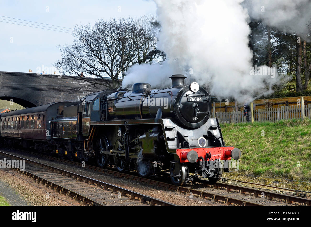 A steam train leaves Weybourne Station on the North Norfolk Railway with a service to Holt on Easter Monday 2015. Stock Photo