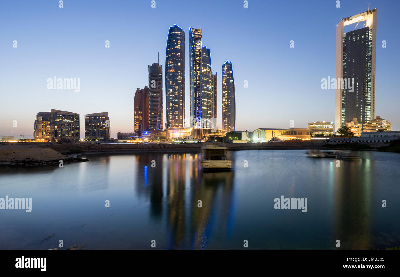 Night skyline view of Etihad Towers  in Abu Dhabi in United Arab Emirates Stock Photo