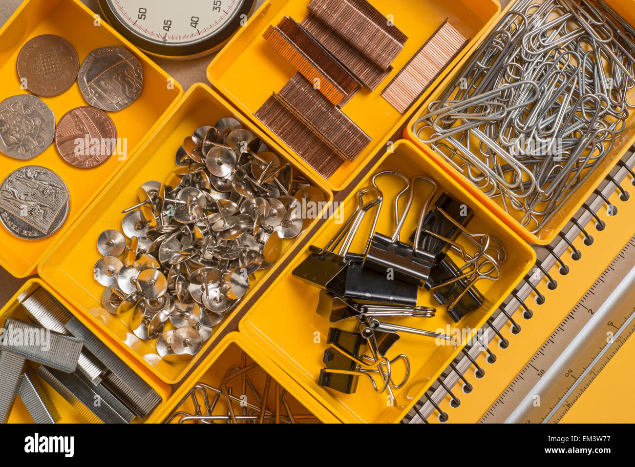 A group of items typically found in a office desk - Stock Image