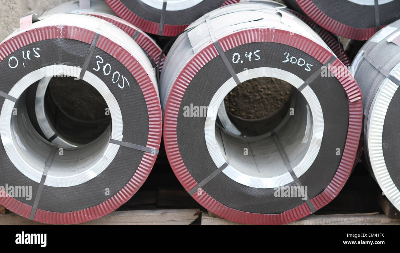 Rolled galvanized steel with polymer coating on the metal rolling stock - Stock Image