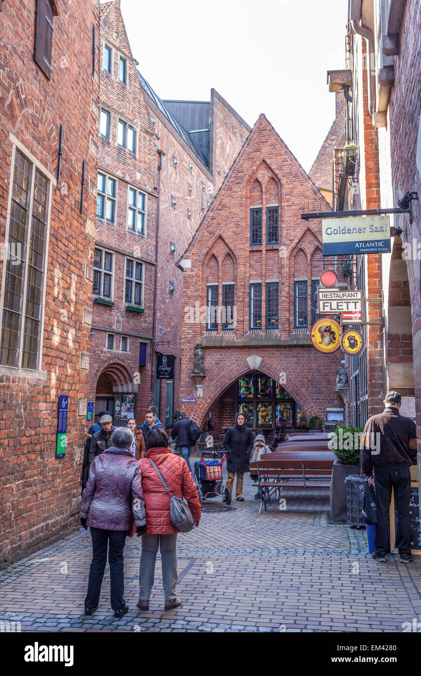 Tourists in the historic Boettcher Street in the old town in Bremen, Germany - Stock Image
