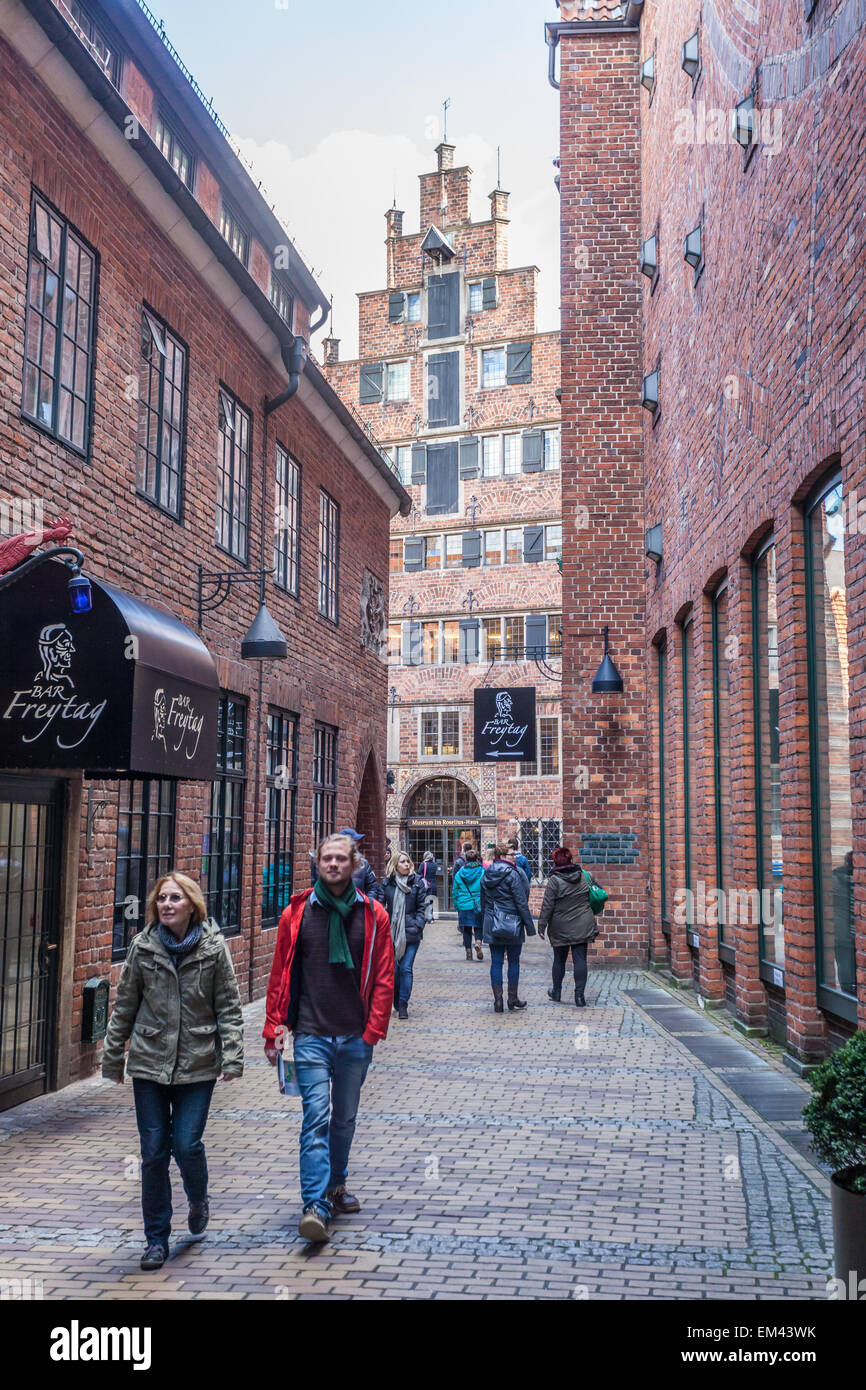 Tourists in historic Boettcher Street in the old town in Bremen, Germany - Stock Image