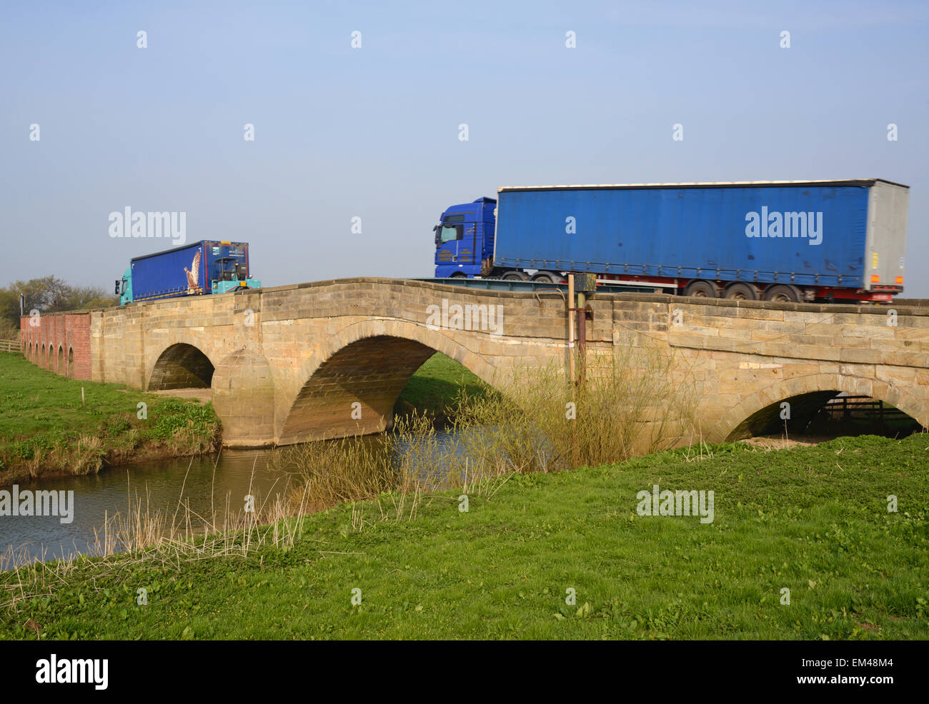 lorry crossing the river Derwent over grade II listed bridge Bubwith Yorkshire United Kingdom Stock Photo