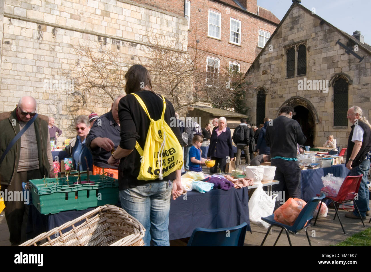 jumble sale sales fundraising fundraiser charity table top tabletop second hand goods - Stock Image