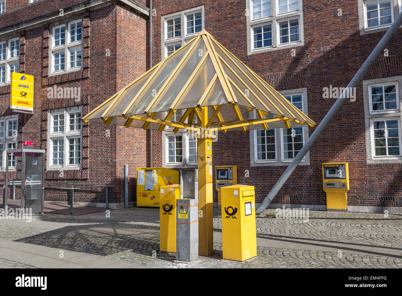 Yellow Mailboxes from the German Postal Service in the city of Bremen, Germany Stock Photo
