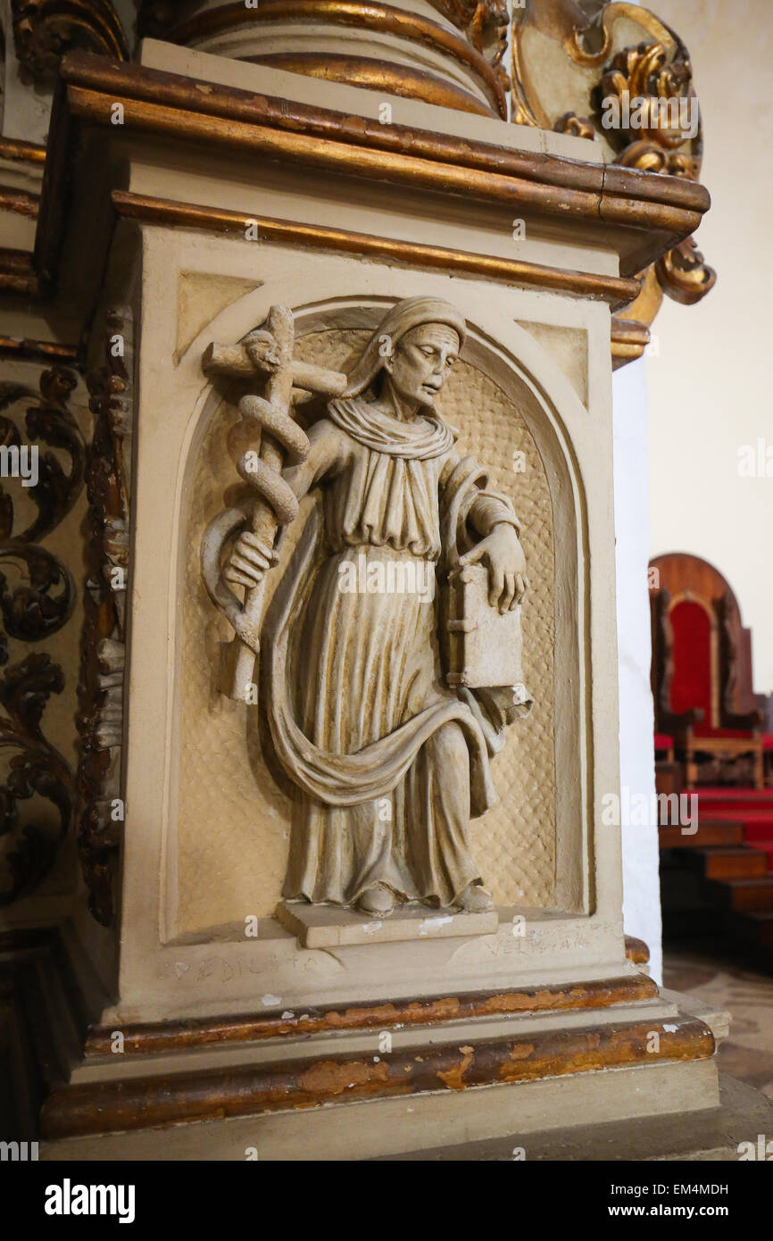 Statue of a saint holding a cross with a serpent draped about it in the Cathedral of Otranto, a town in the province - Stock Image