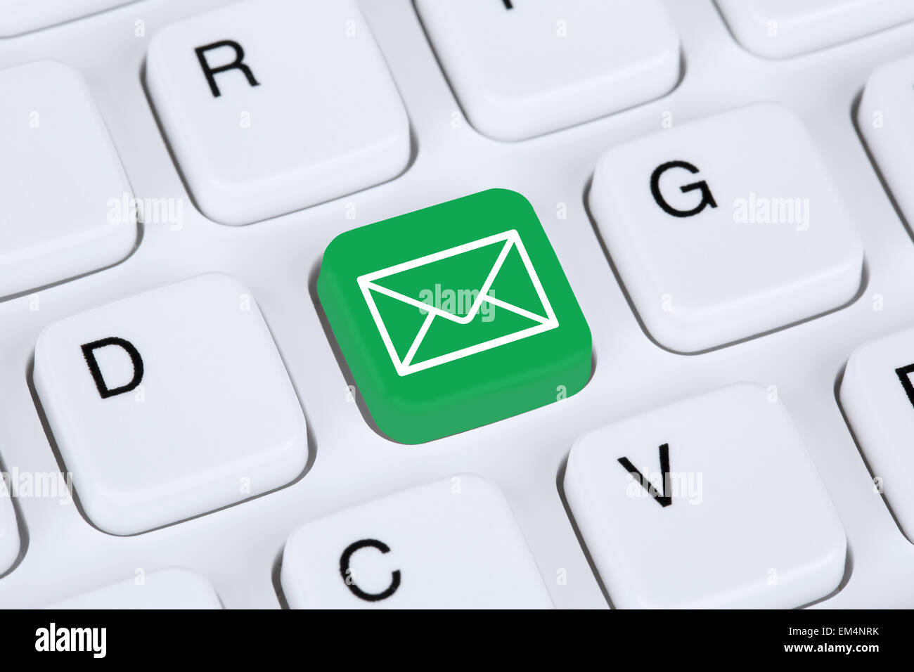 Sending E-Mail via internet on computer keyboard with letter symbol - Stock Image
