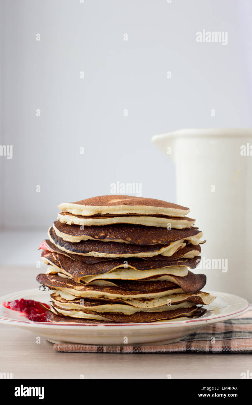 Stack of pancakes on white plate - Stock Image