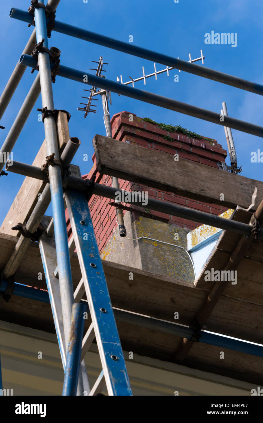 Scaffolding on house for chimney repair - Stock Image