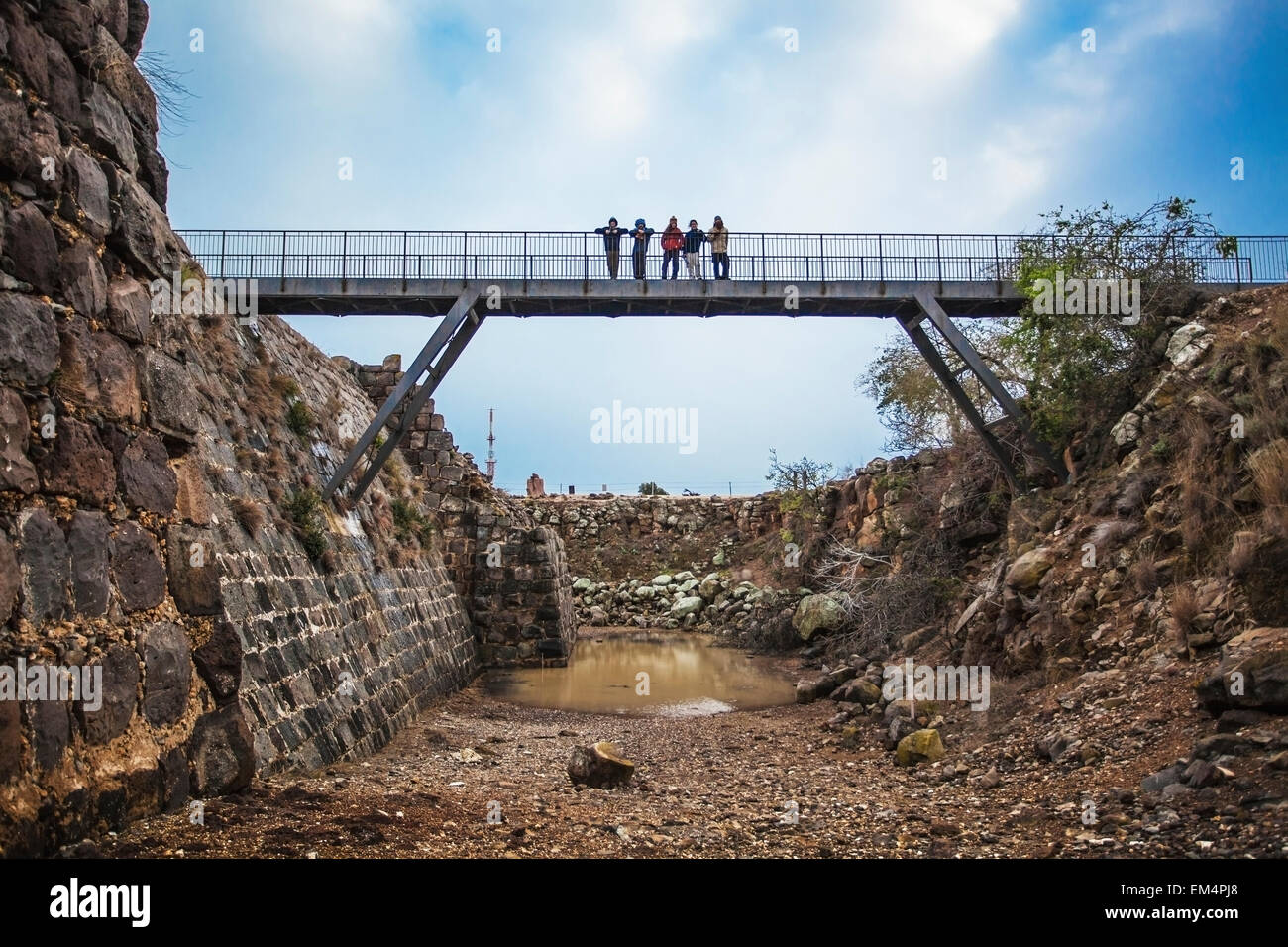 People Standing On A Bridge Over A Moat In Kokhav Ha Yarden National Park; Israel Stock Photo