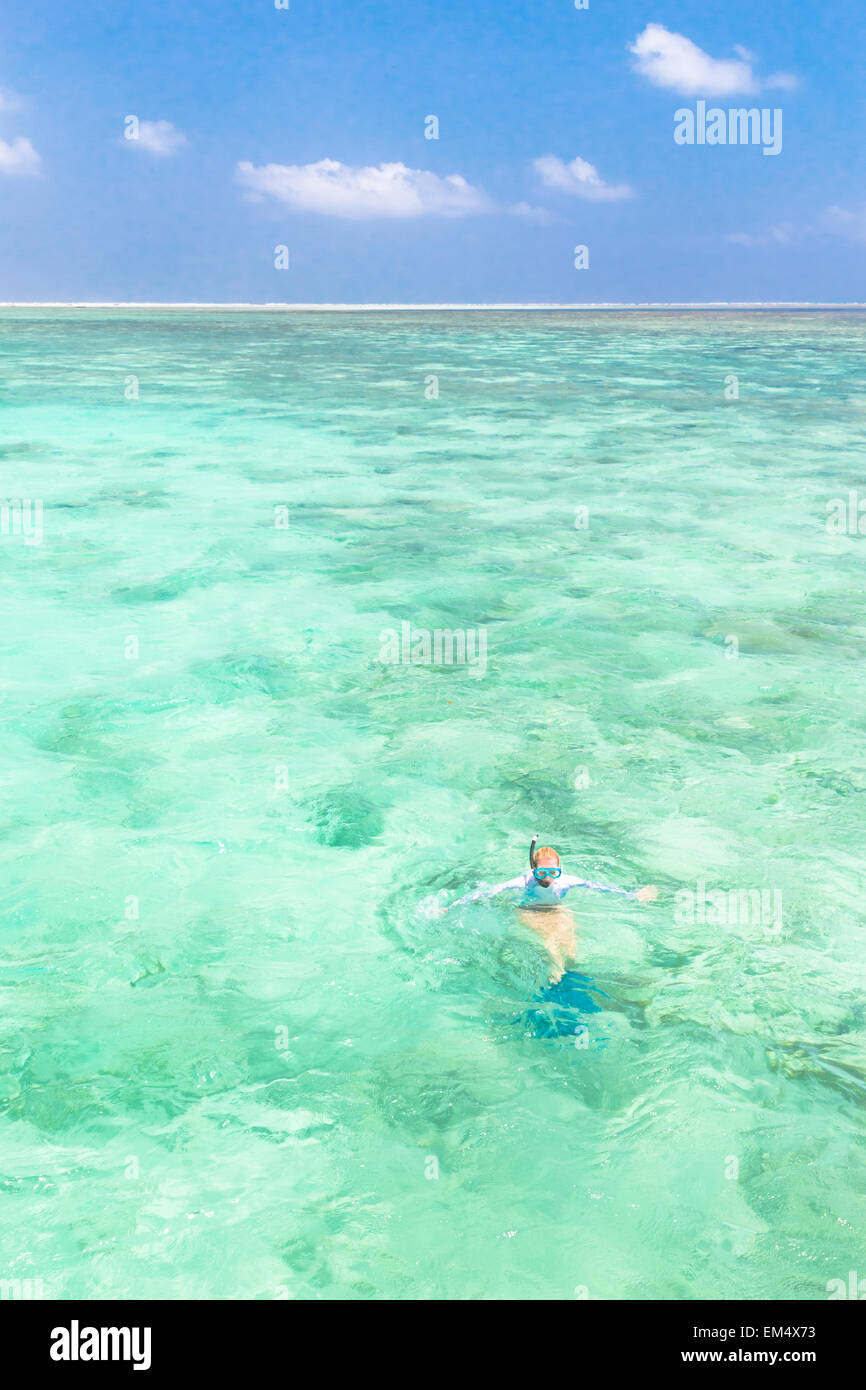 woman snorkeling in turquoise blue sea. Stock Photo