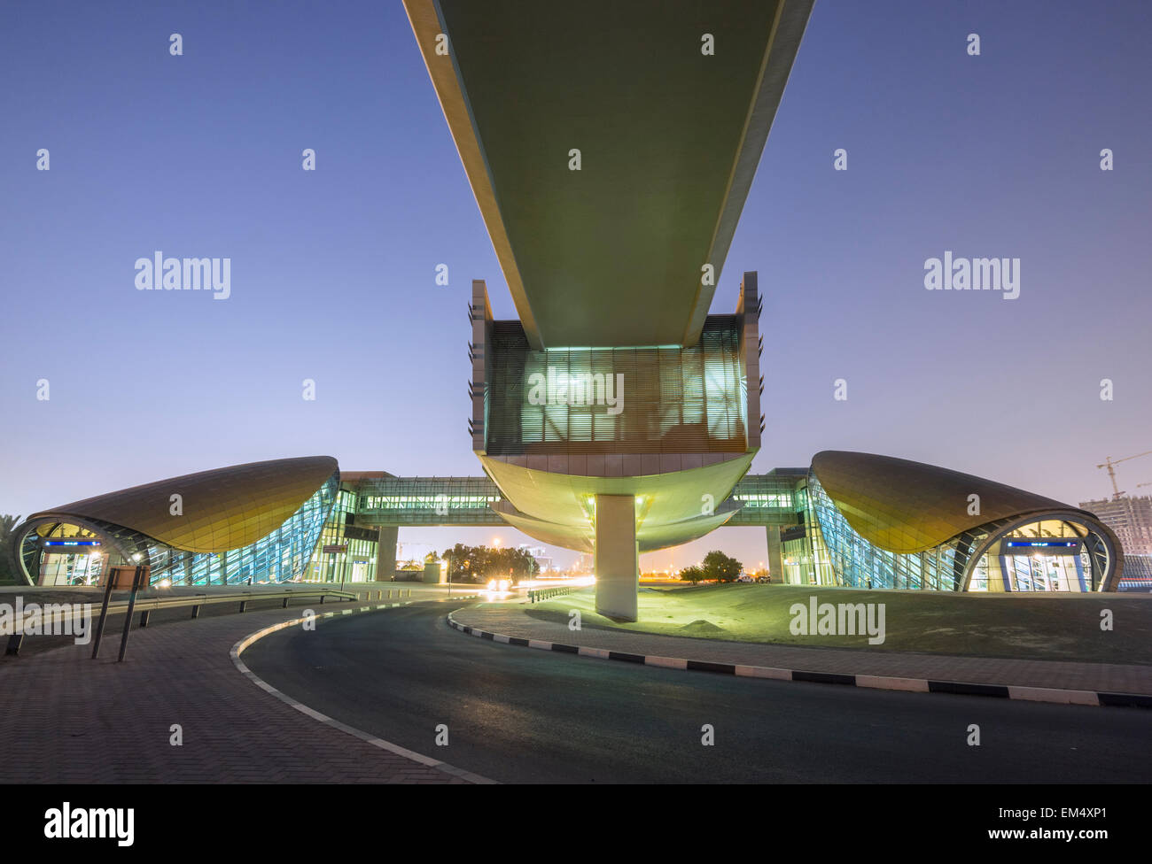 Modern metro railway station at night in Dubai United Arab Emirates - Stock Image