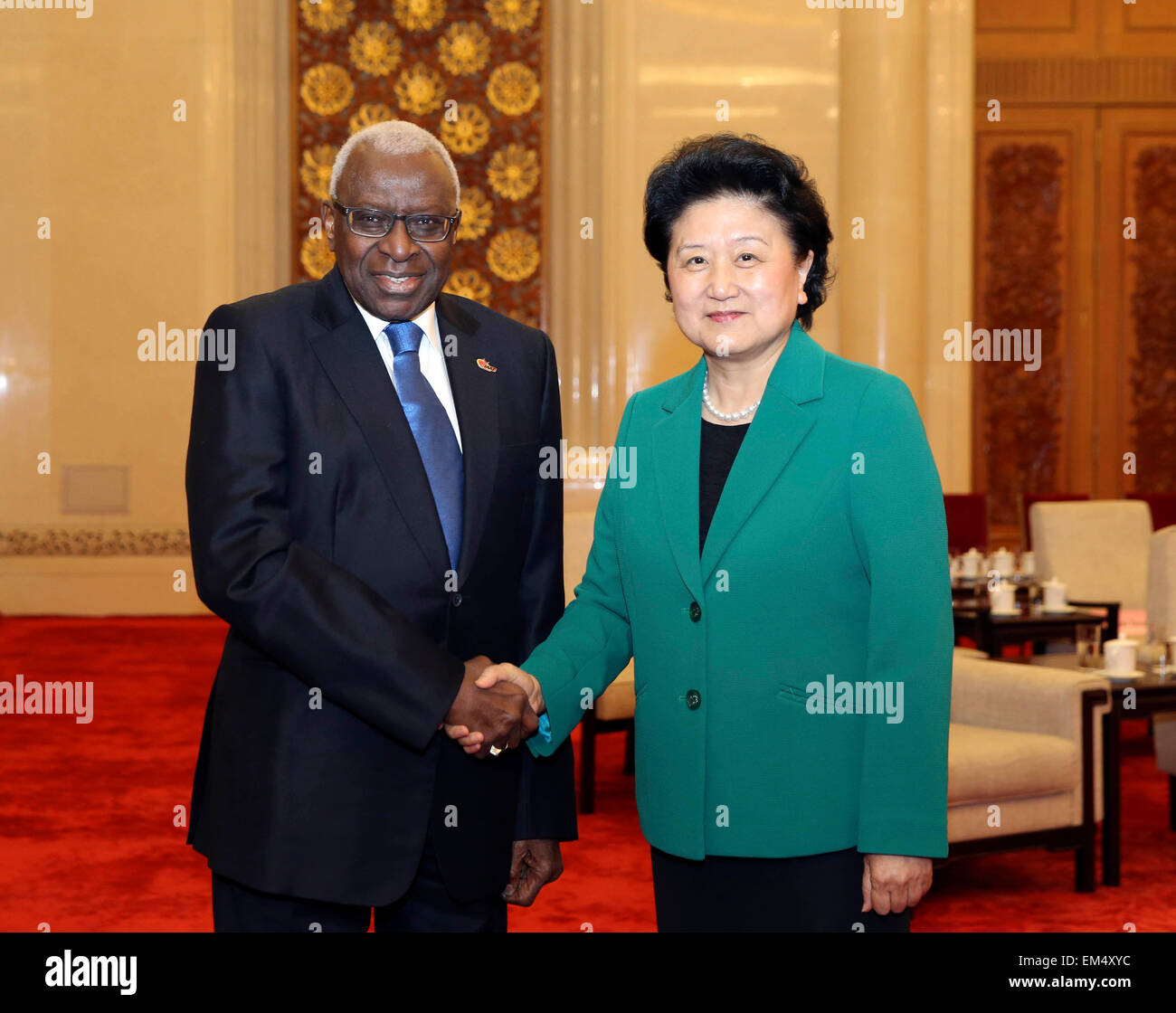 Beijing, China. 16th Apr, 2015. Chinese Vice Premier Liu Yandong (R) meets with Lamine Diack, president of the International - Stock Image