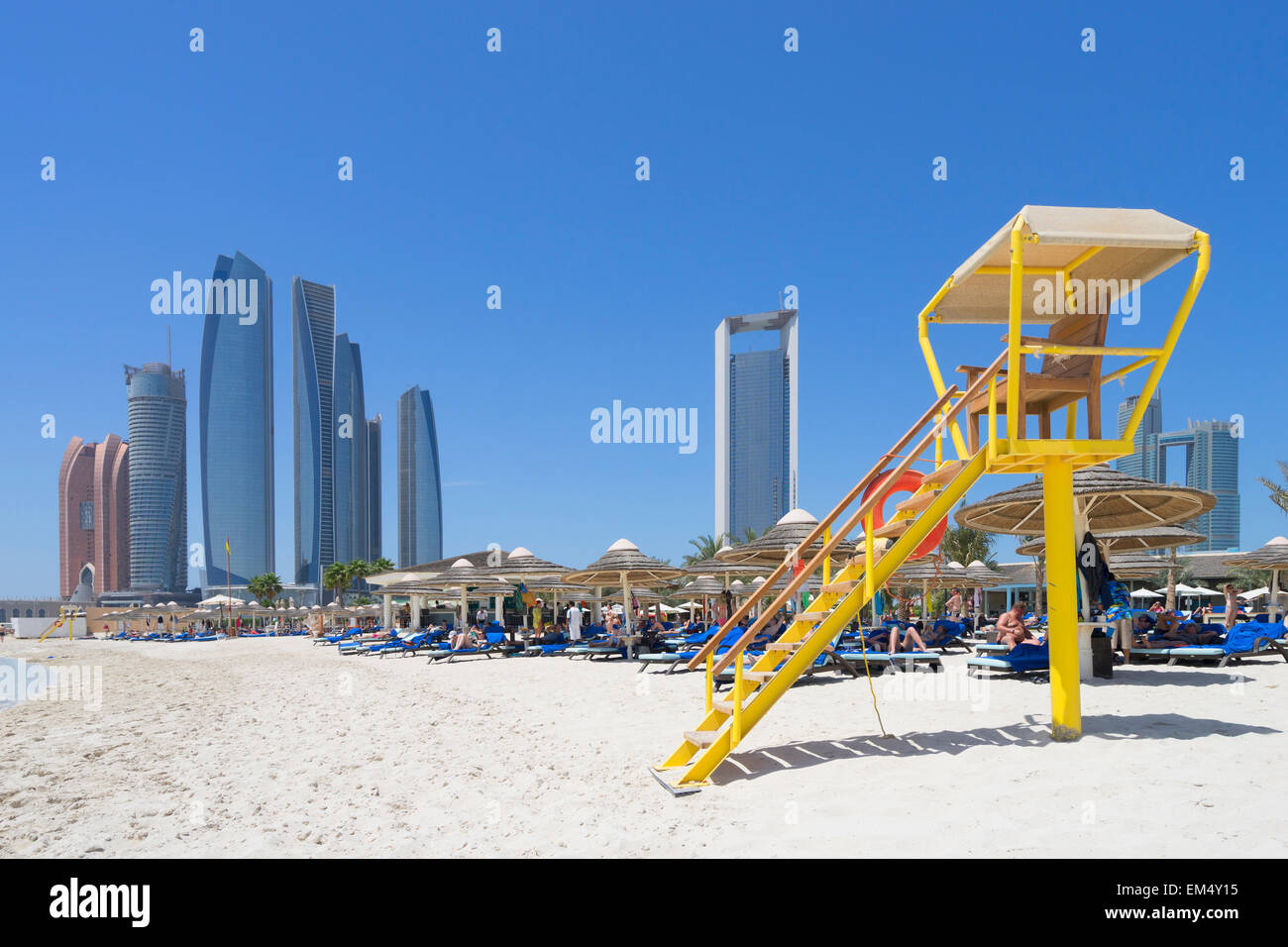 Skyline view of Etihad Towers from luxury hotel beach in Abu Dhabi in United Arab Emirates - Stock Image
