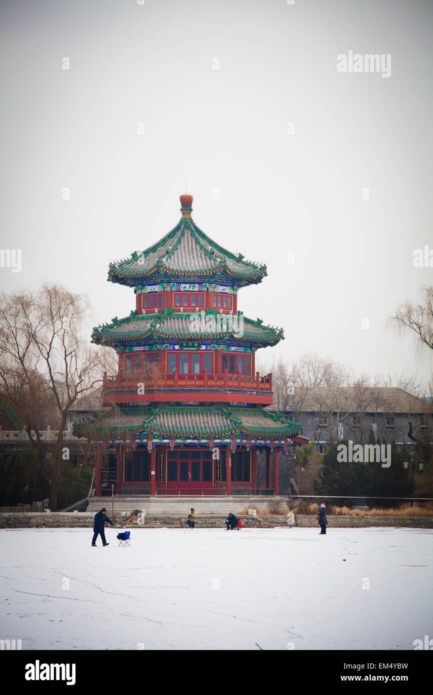 People walking on lake at Houhai Park; Shichahai, Beijing, China - Stock Image