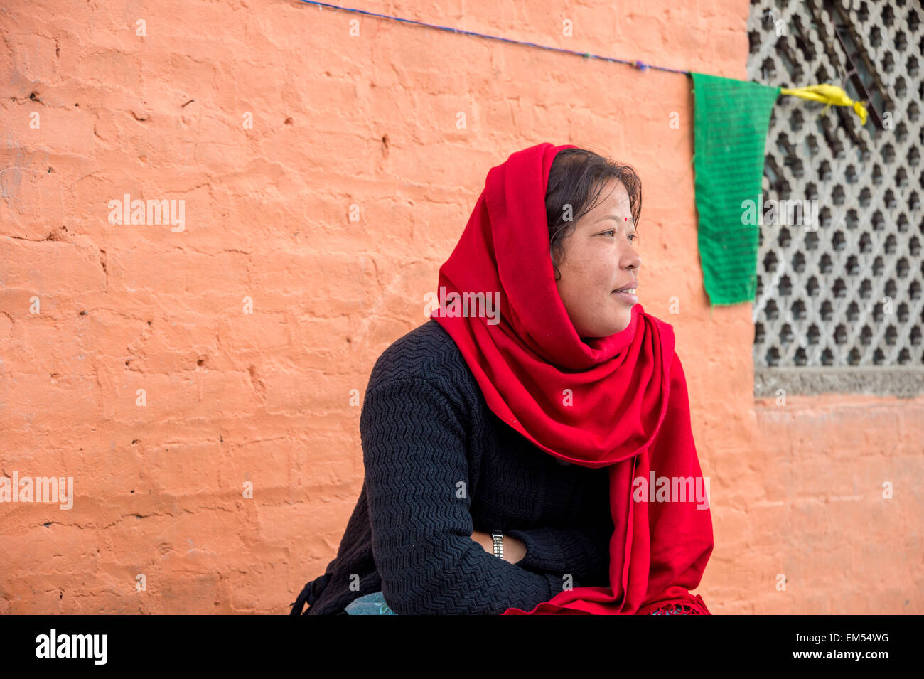 Nepali woman with red scarf in Kathmandu - Stock Image