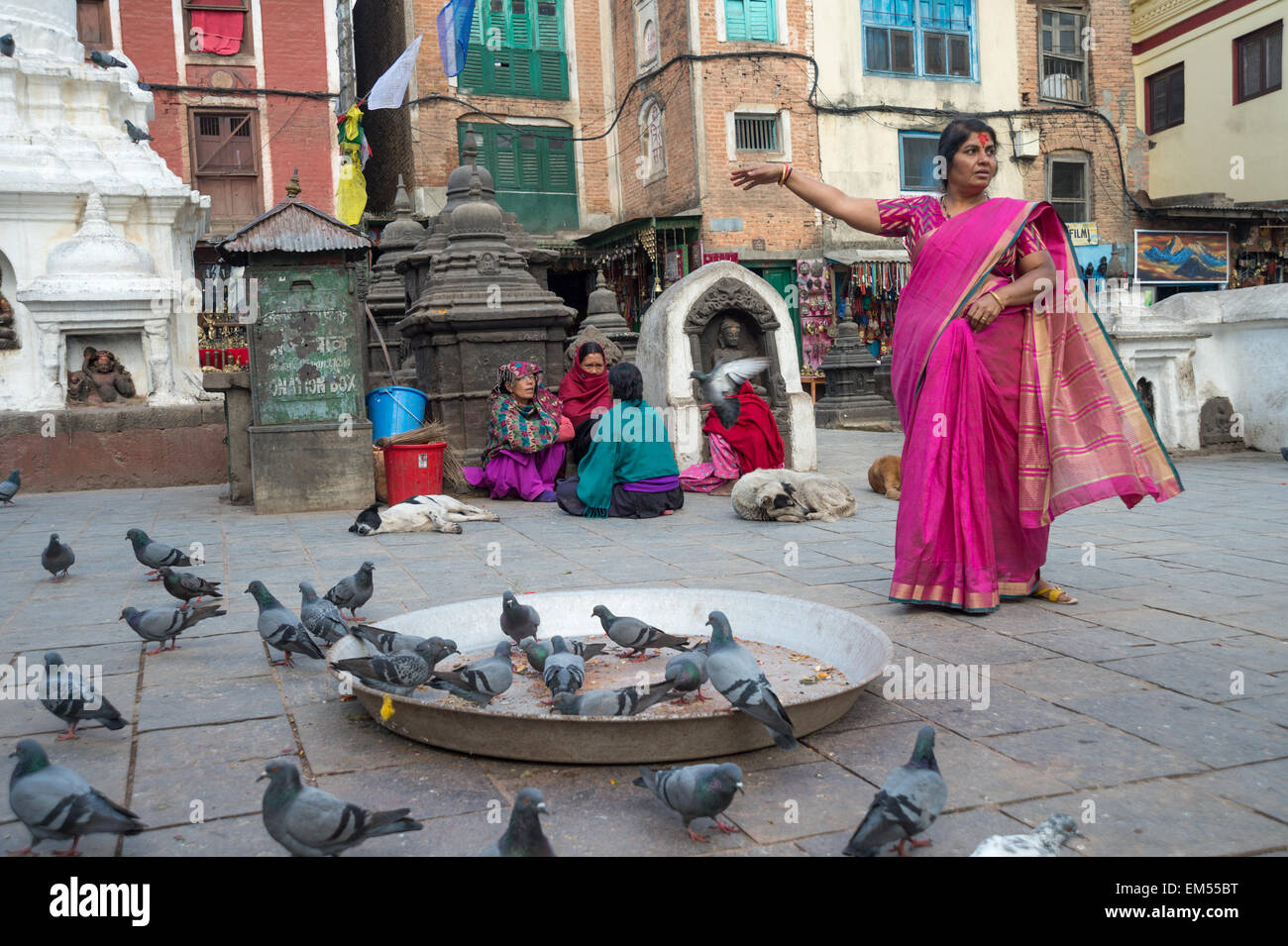 Nepali woman posing for a photographer at Monkey Temple in Kathmandu - Stock Image