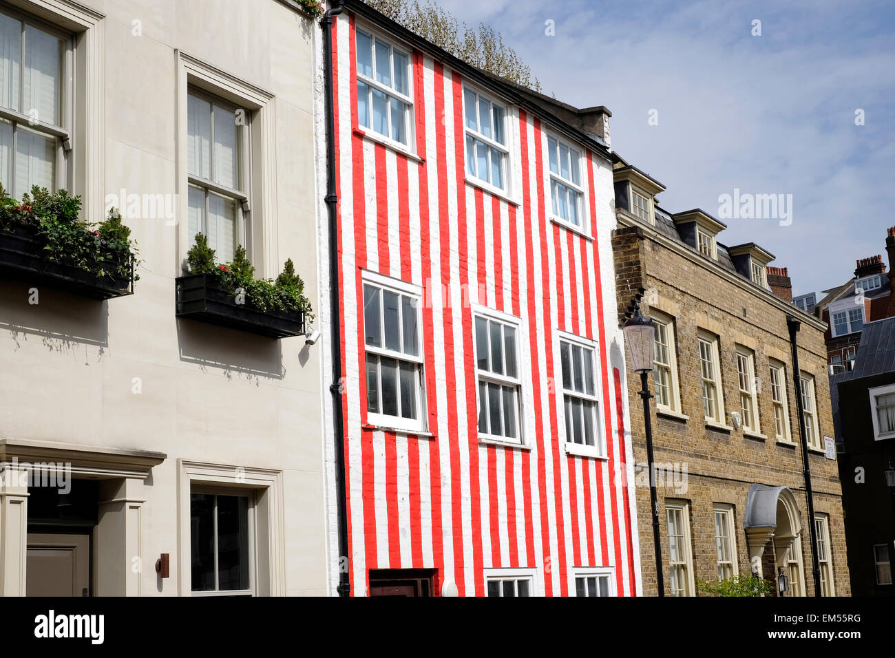 A general view of a town house painted in red and white stripes ...