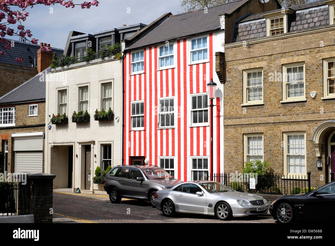A general view of a house painted in red and white stripes Stock ...