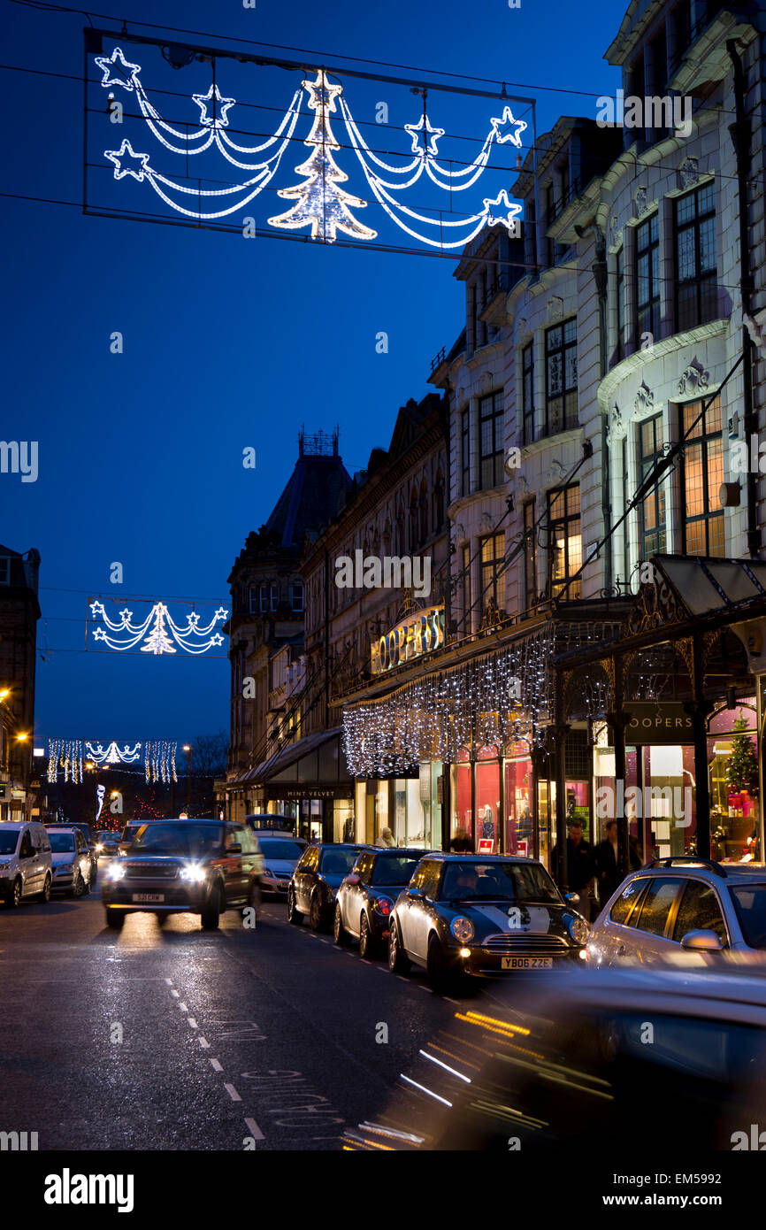 UK, England, Yorkshire, Harrogate at Christmas, James Street, Hoopers department store lit at dusk - Stock Image