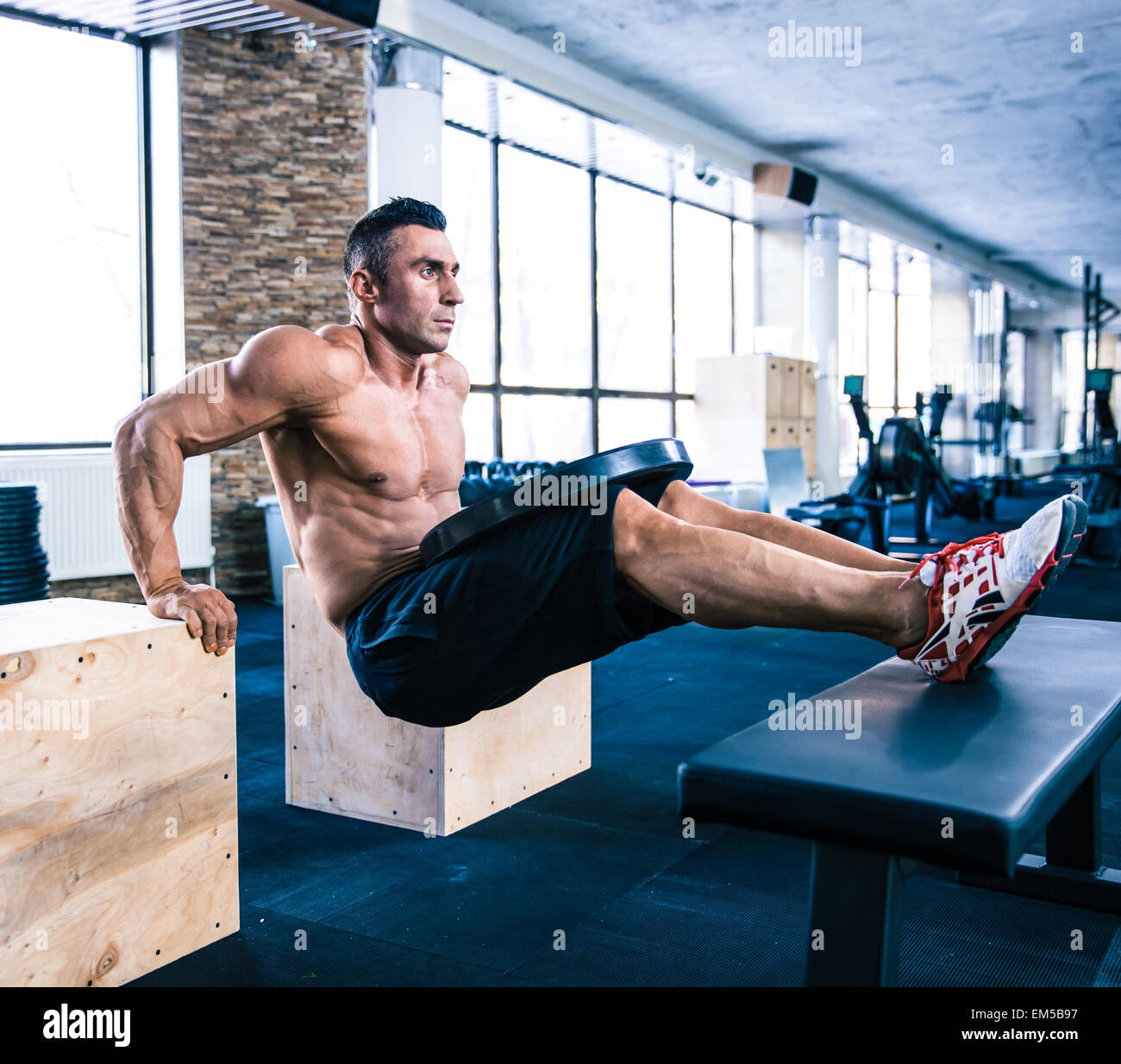 Handsome muscular man workout at crossfit gym - Stock Image