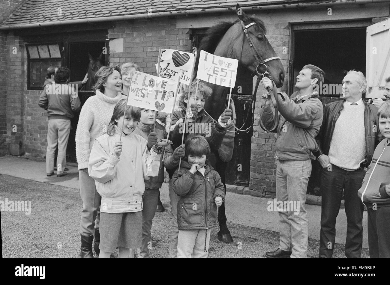 West Tip seen here on his return to his stables after winning the 1986 Grands National surrounded by local schoolchildren - Stock Image