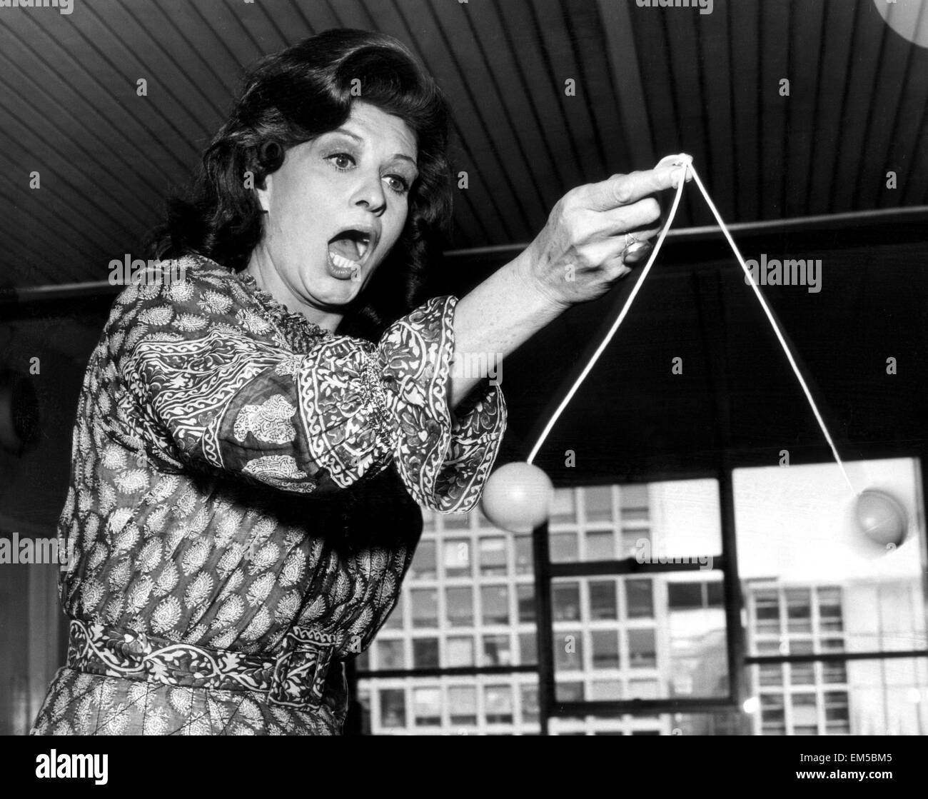 Model Caroline Munroe tries to get to grips with the latest craze, the Ker-knockers. 20th August 1971. - Stock Image