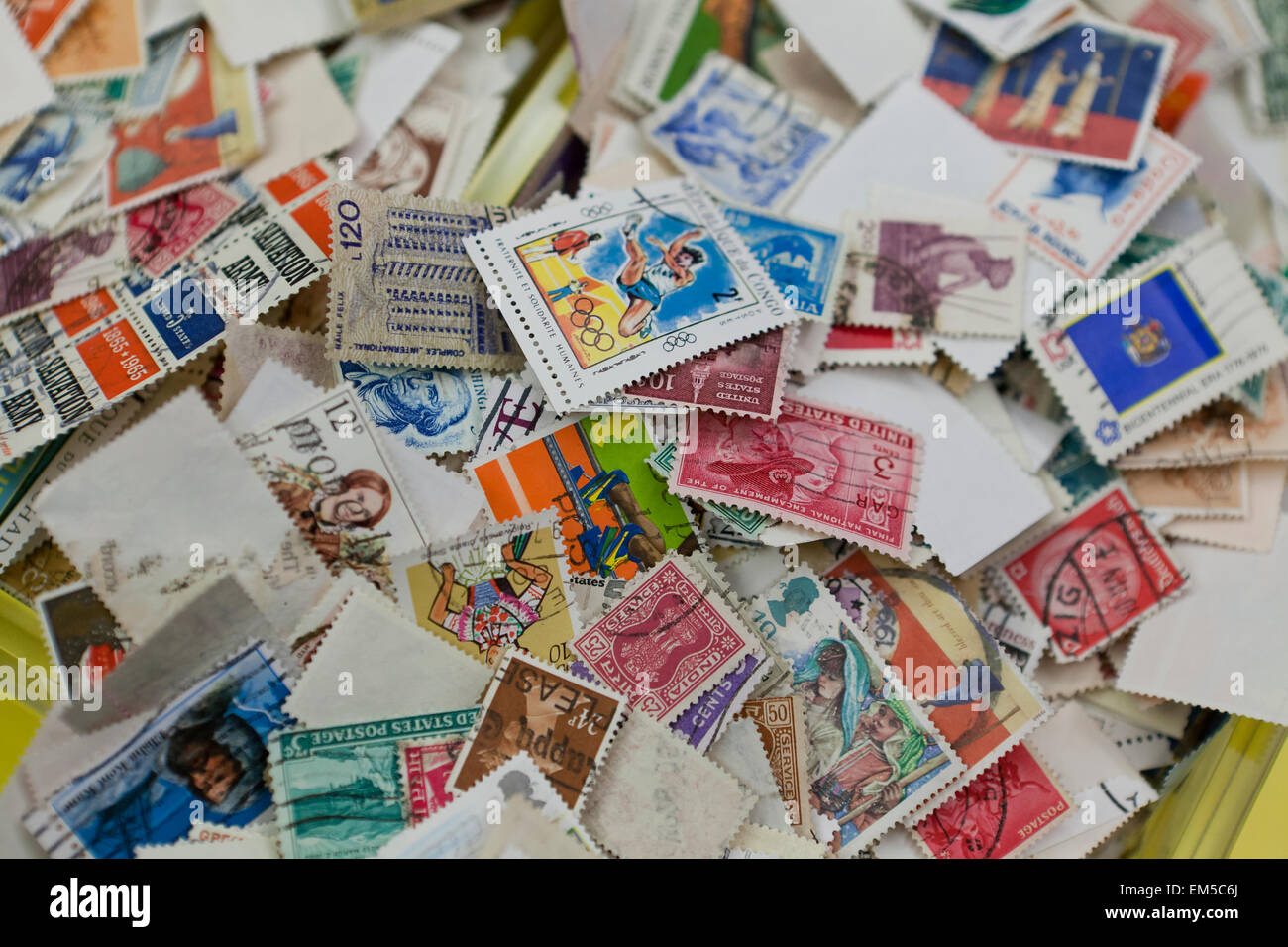 Used stamp collection in a pile - USA - Stock Image