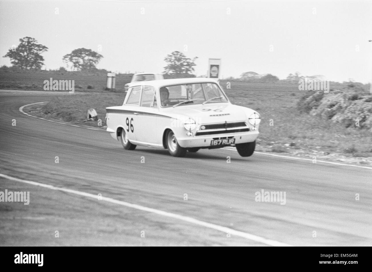 Jim Clark in the Team Lotus Cortina seen here lifting a wheel through the esses at Snetterton during the Saloon Stock Photo