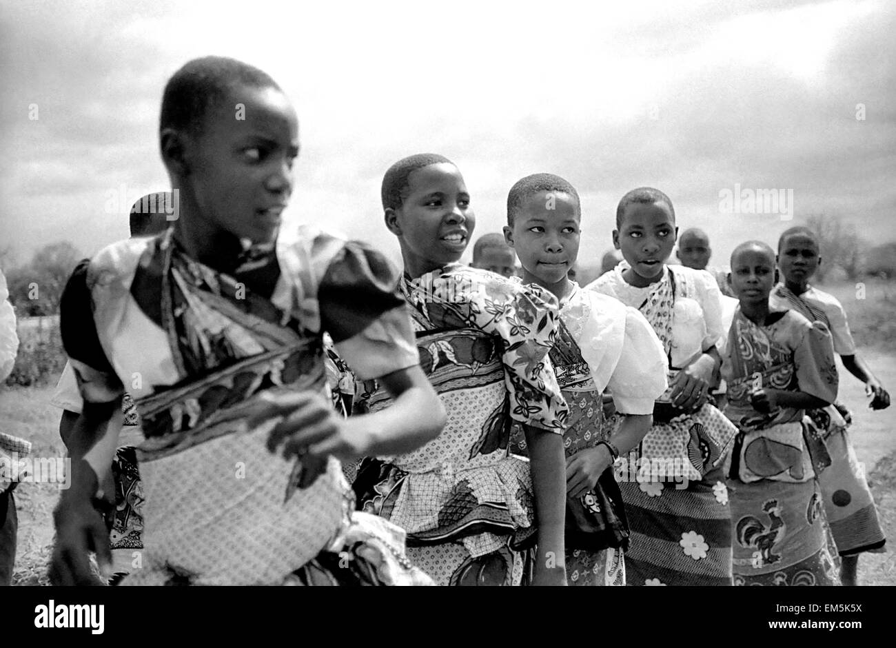 """Girls dancing in a Harambee in Ikutha village for take money for the people with AIDS. Harambee is Swahili for """"all - Stock Image"""