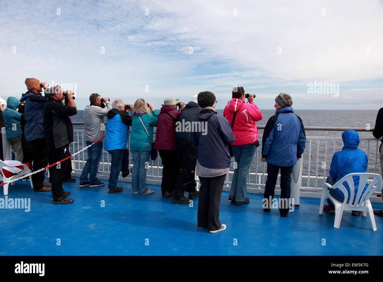 Passengers on the Brittany ferry Pont Aven looking for whales and dolphins - Stock Image