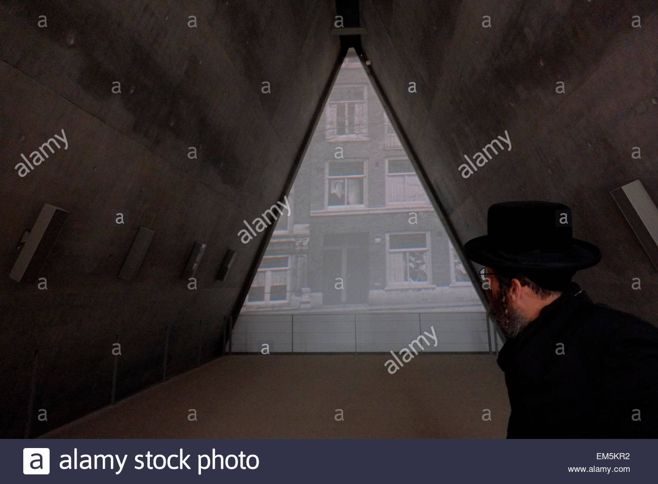 An Orthodox Jew watching archive material at Yad Vashem History Museum for Holocaust in Jerusalem Israel - Stock Image