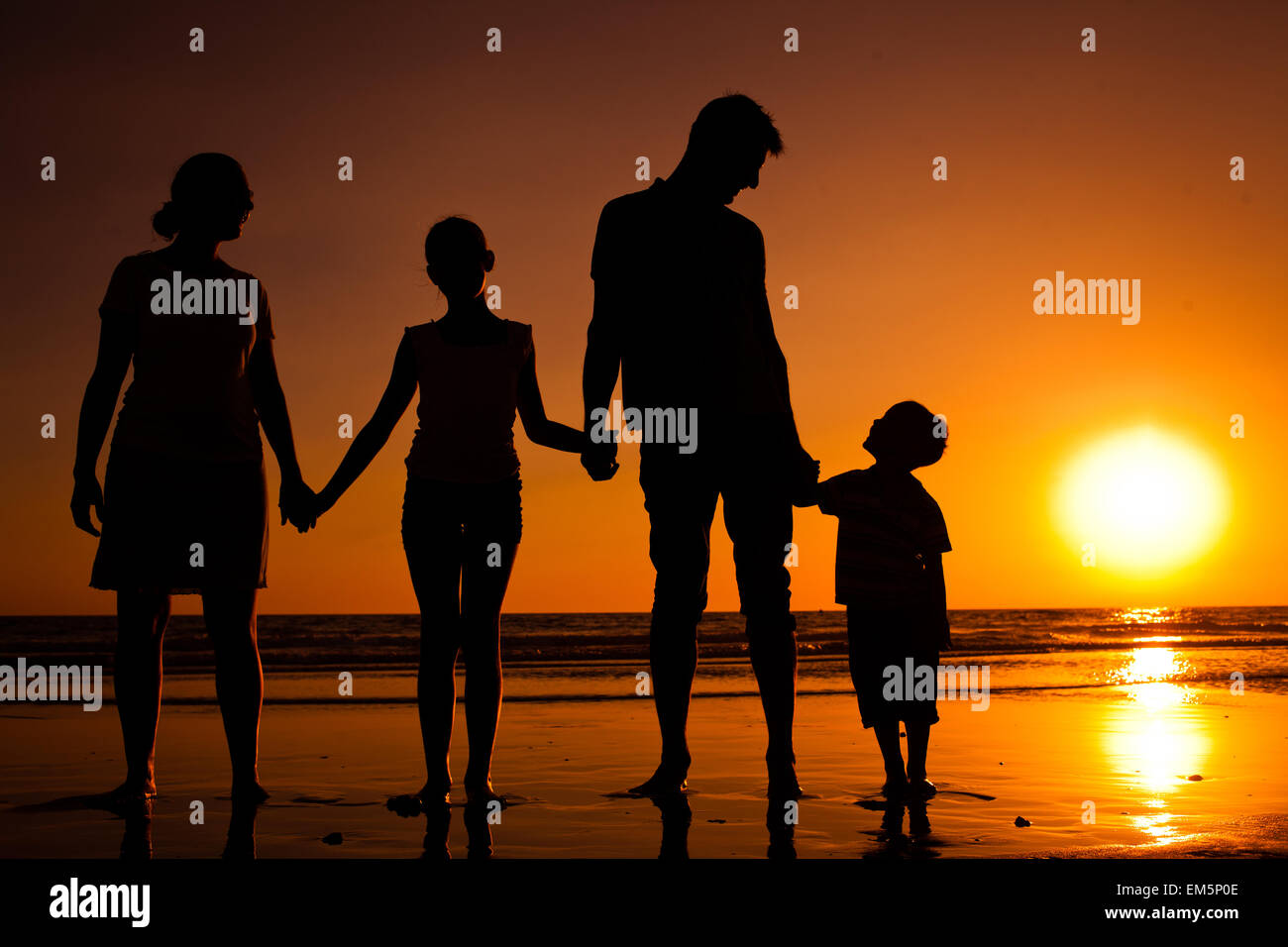 Silhouette of family - Stock Image