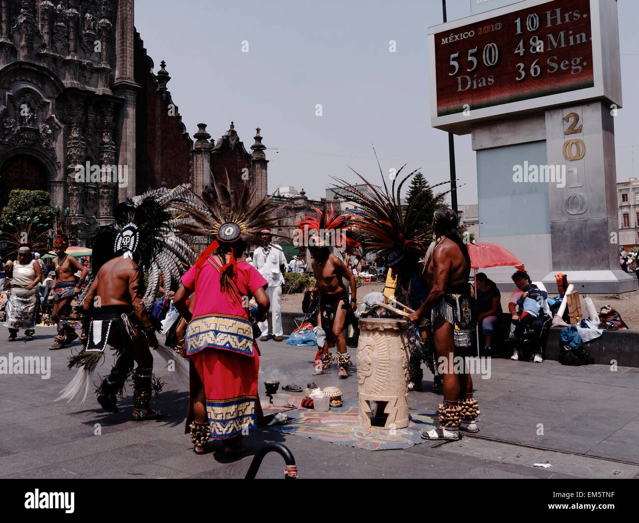 native Aztec dancers dancing performing in feathered headdress in the Zocalo, Mexico City, Mexico, North America - Stock Image