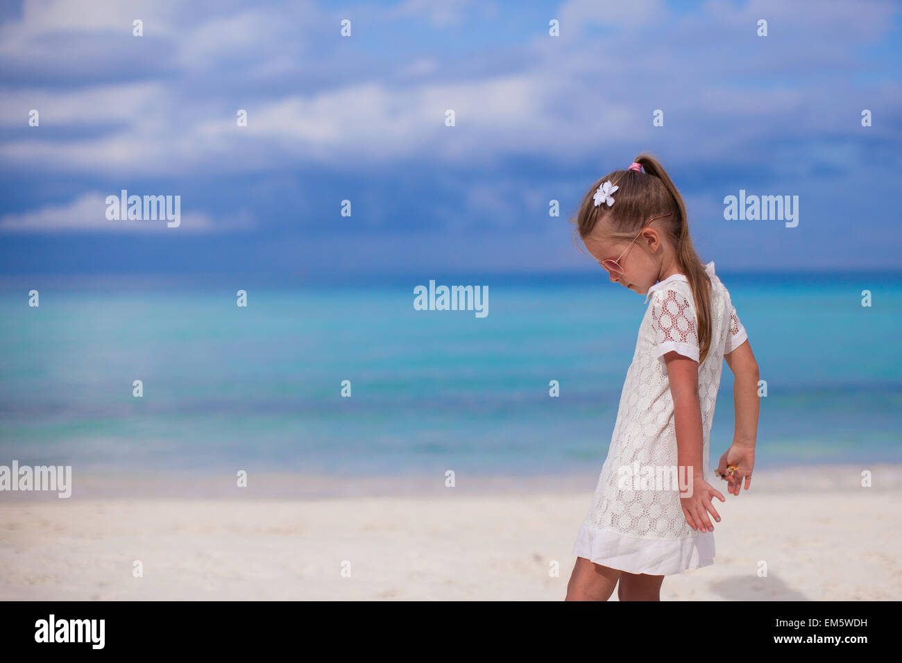 bbec130b4d3 Cute little girl walking on tropical beach vacation Stock Photo ...